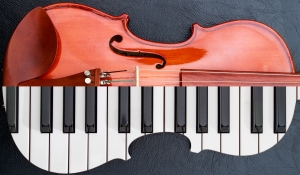 Piano Keys In To The Violin On The Black Leather Table, Half Key